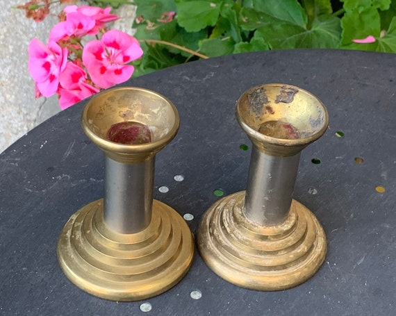 Pair of empire style brass candlesticks, column shape, two-tone gilded metal and silver metal