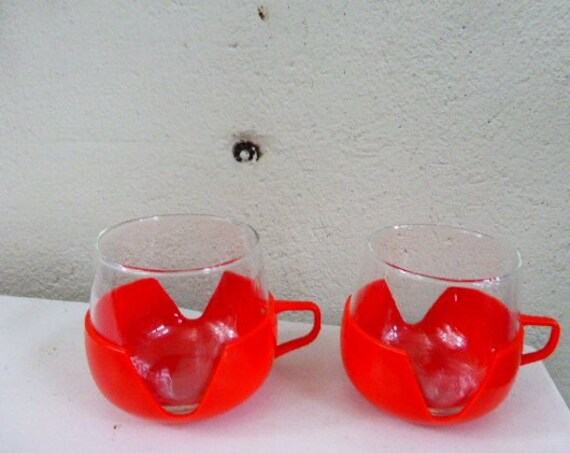 Two cups clear glass and vintage red plastic 1970