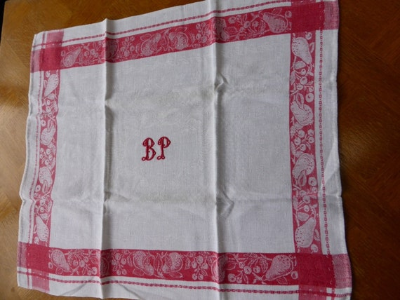 2 old tea towels, monogrammed, red embroidery on white damask, red fruit borders, old