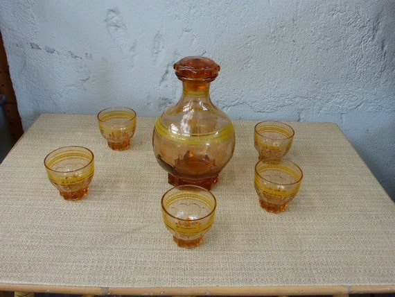 "Decanter and 6 GLASSES of ""liquor"",  VINTAGE 1950, glass, colors, pink and yellow"