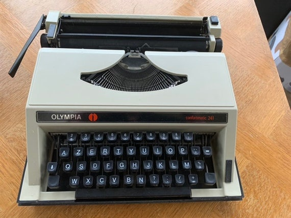 OLYMPIA COMFORMATIC 241 vintage portable typewriter, Made in Italy, with its original black plastic box, collector