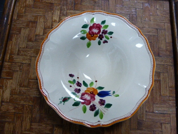 Lots of charm for this fruit cup, with flowers, vintage