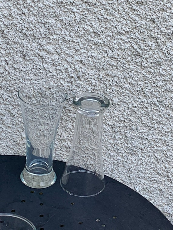 Anisette service consisting of 4 high transparent glasses, a ricard sun model decanter and a vintage yellow plastic ricard ice bucket