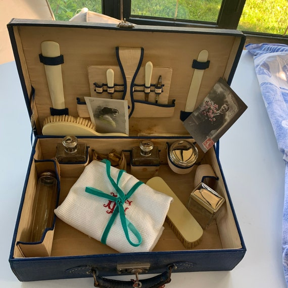Toiletry case, blue leather case, art deco with charming elements in crystal glass and silver metal and ivory bakelite, collection
