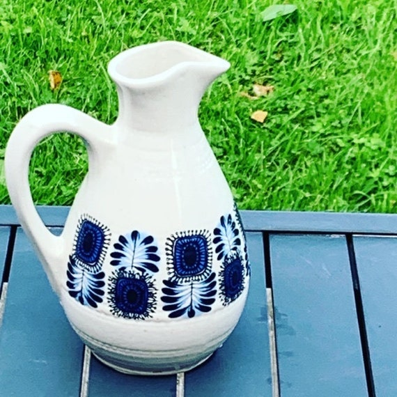 Jug, decanter, enamelled stoneware with a pretty pattern of vintage blue flowers and 1970 design.