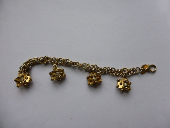 Jenny d'Ormond gold and silver metal charm bracelet