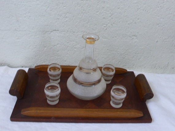 Liquor service in white granite glass and gold edging on a small vintage wooden inlaid tray 1940/50