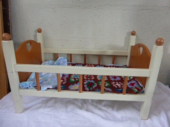 BED for DOLL, brand NATHAN, has bars in white and brown varnished wood, heart cut on the uprights, bed linen provided vintage