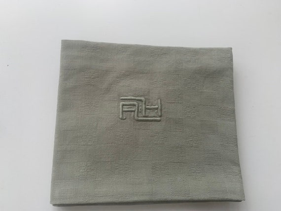 6 large napkins and a tablecloth monogrammed AH, tinted khaki green, old, embroidered and damasked