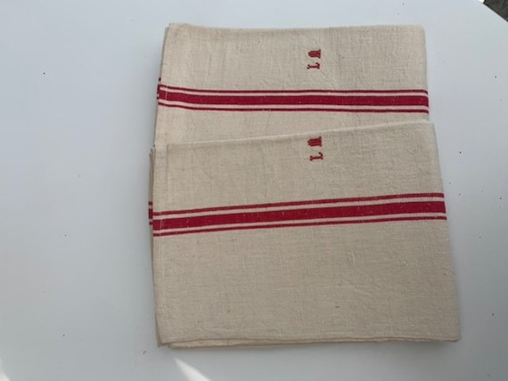 Two old tea towels, beige hemp fabrics and red bands, embroidered LM monograms, art deco