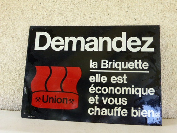 """Metal advertising plate for Union """" ask for the briquette: it is economic and warms you well """". This signed by JOST"""