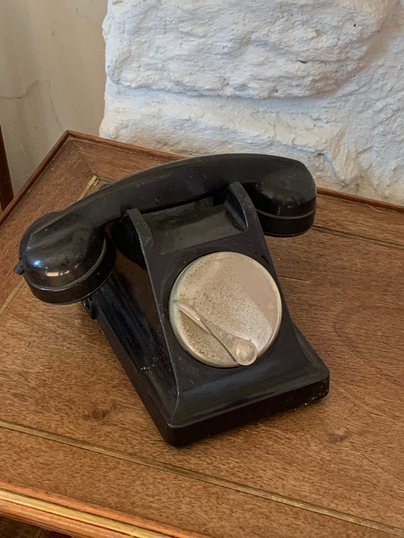 Telephone with metal dial and vintage black Bakelite 1964 made in France for collector's decoration