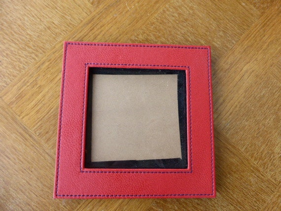 Square frame in red imitation leather back in black veins