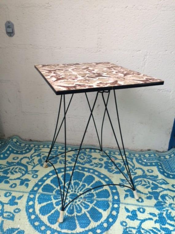 side table with pretty metal feet in black Eiffel style, vintage 1960.