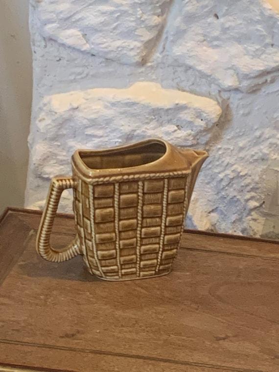 Jug, carafe barbotine in beige enameled ceramic, braiding pattern