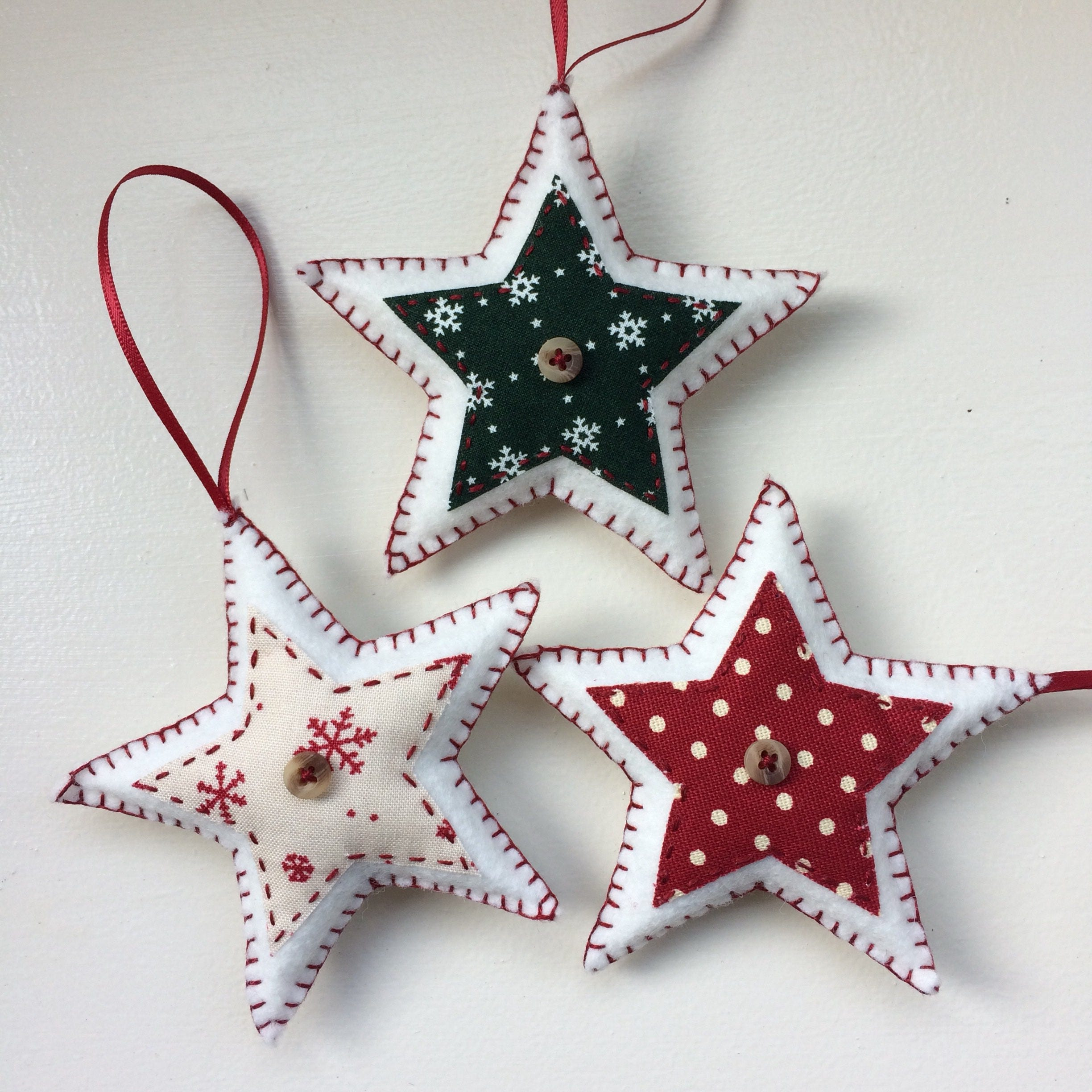 The Best Handmade Christmas Decorations: Set Of Three Star-shaped Felt Christmas Decorations