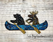 Bear and Moose in a Canoe glass mosaic