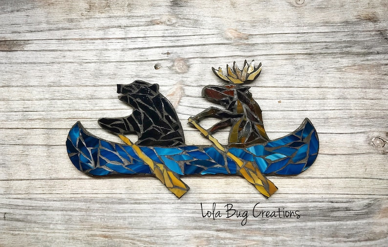 Bear and Moose in a Canoe image 0