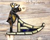 Moose on a dog sled glass mosaic