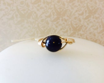 Blue goldstone wire wrapped ring