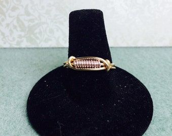 Pink and gold tone wire wrapped ring