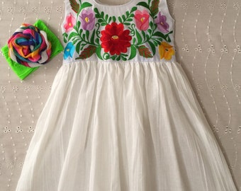 a92d87065 Beautiful Mexican girl dress embroidered with colorful Flowers.