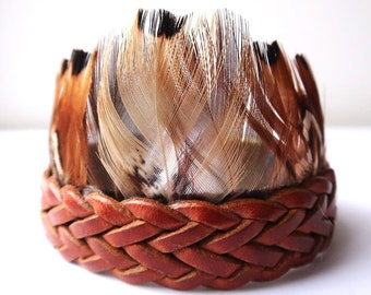 Natural braided leather cuff bracelet and natural golden pheasant feathers with magnetized clasp