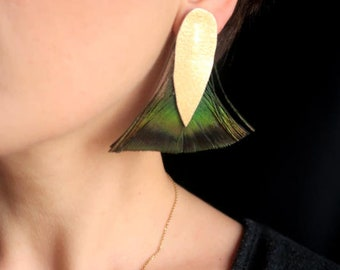 Leather earrings and peacock feathers