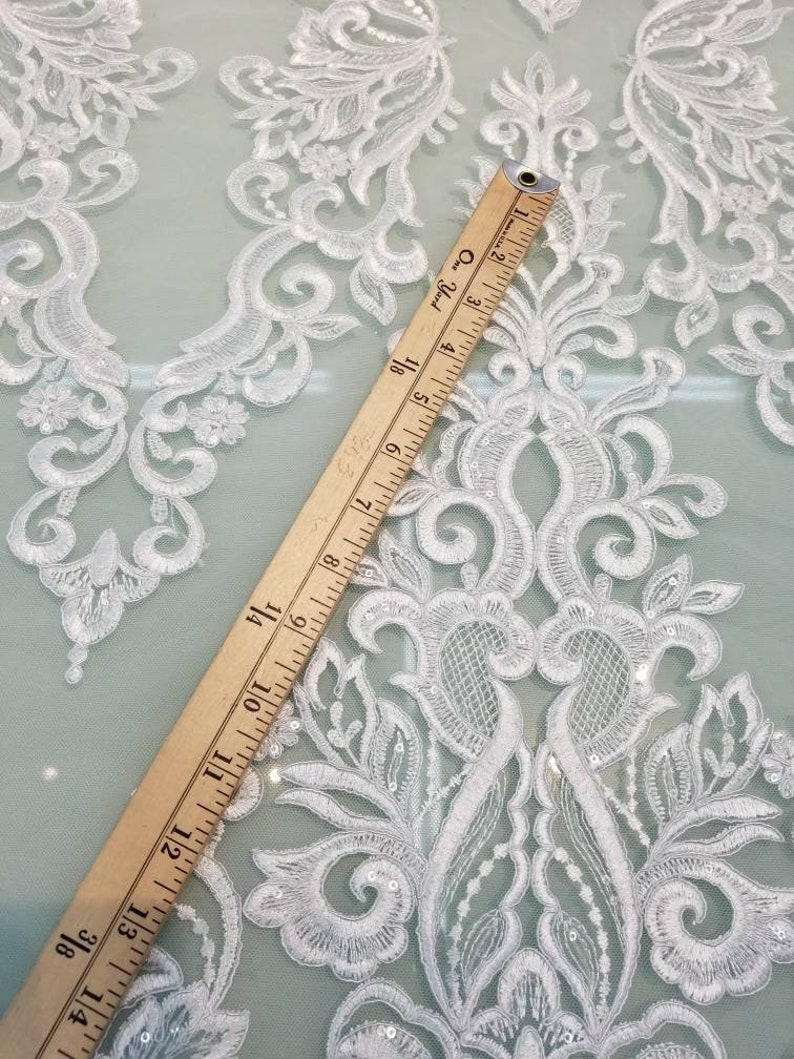White color cording my lady chantelle French lace designed for apparel accessories and interior designs 52 wide.
