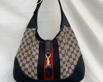6bfe4c4d Authentic Gucci Jackie Bag in Navy