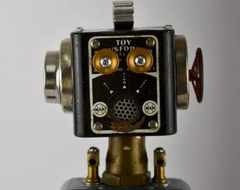Model Train Transformers inspired the design for this one of a kind Assemblage Art Robot. Train enthusiasts/ HO scale train fan/nostalgia