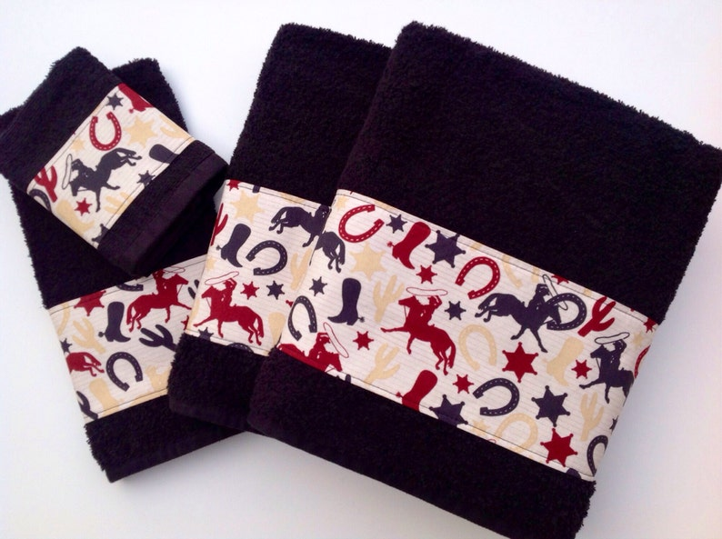 Western theme on plush black towels.  Perfect for that ranch image 0