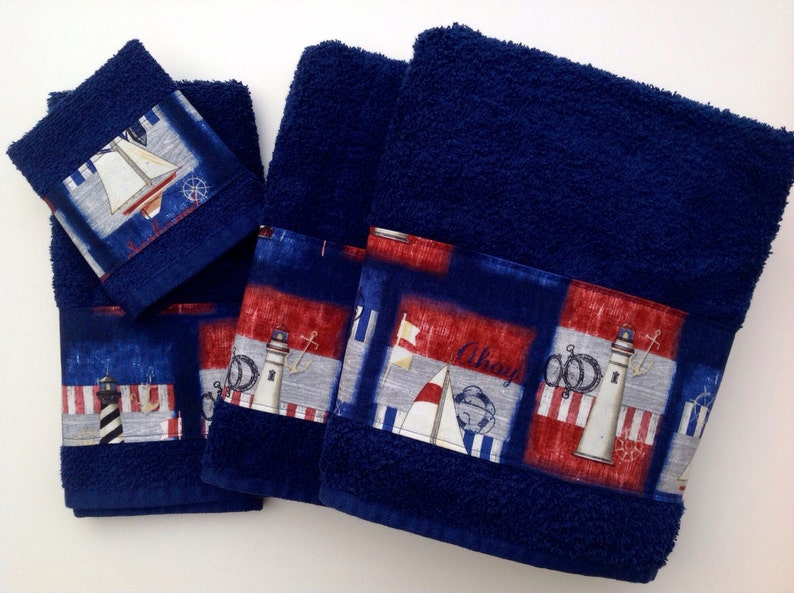 Blue towels with a beautiful nautical themed trim to decorate image 0
