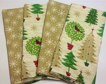 Set of 4 double-sided napkins Christmas trees are the main focus on these napkins.  The back has snowflakes that go with the front.