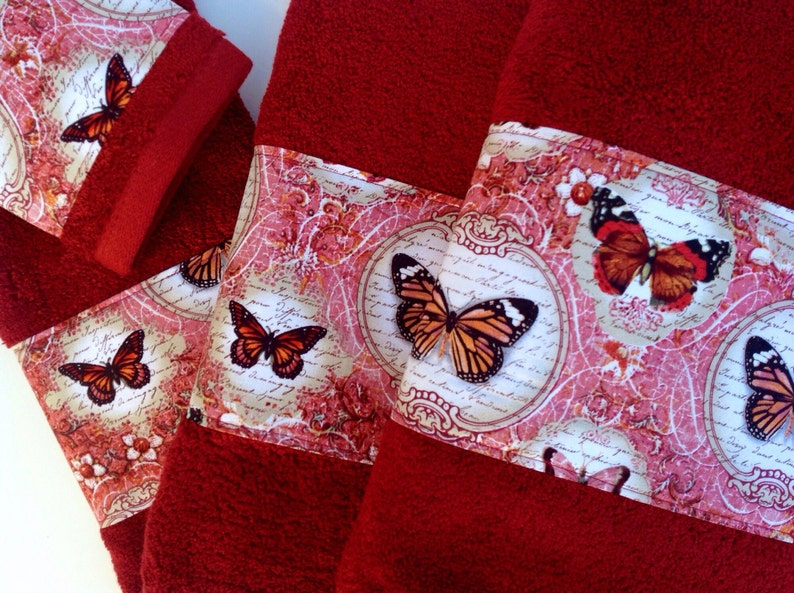 Elegant bath towels with beautiful butterfly fabric trim. image 0