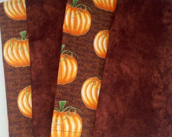 Pumpkins are perfect for Fall & Thanksgiving, a touch of gold for sparkle.  Set of 4 double-sided napkins.  Backing is browns to compliment