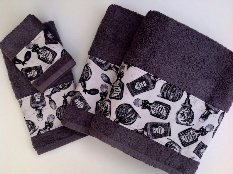 Grey towels with a beautiful trim to decorate any bathroom. image 0