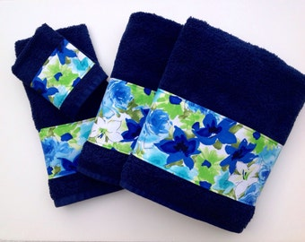 Blue towels with a beautiful floral  themed trim to decorate any bathroom.  great way to change up your bathroom.  Great gift for the holid