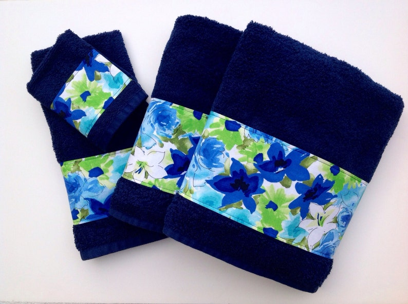 Blue towels with a beautiful floral  themed trim to decorate image 0