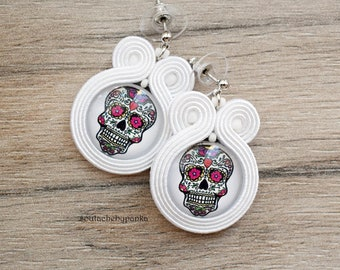 White earrings with skull.
