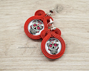 Red earrings with skull.
