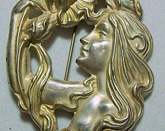 Art Nouveau Sterling Silver Woman and Flower Brooch