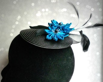 Chic blue fabric flower fascinator sparkly bow and feathers