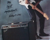 Robert Cray plays the Blues on a Fender Stratocaster guitar 1986 photo print Advertisement