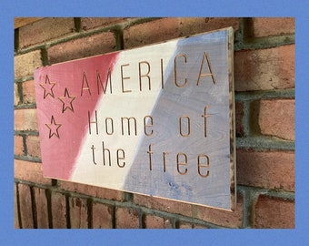 AMERICA Home of the Free sign with stars and red, white, and blue paint - includes a hanging groove