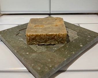 Marbled green corian carved soap dish with honey almond vegan soap