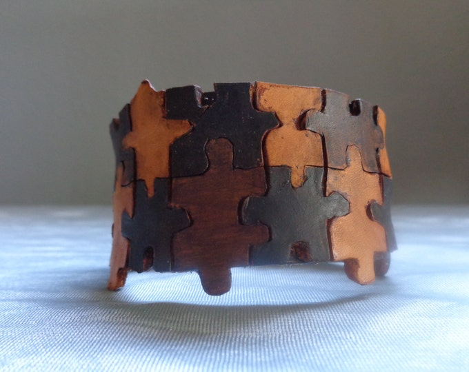 Leather Cuff by Artrix Leather and Fine art -Puzzle Cuff
