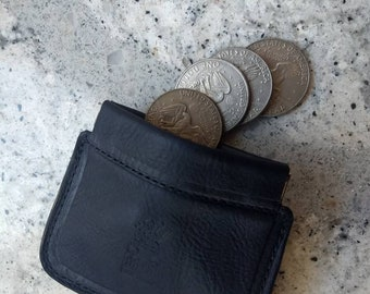 Leather coin purse with squeeze frame