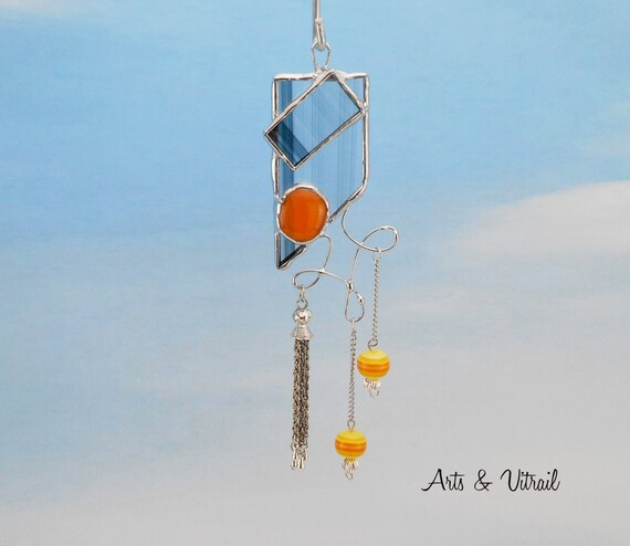 "Stained glass suncatcher, 6 ""high (14.4 cm), black glass clear and cabochon orange or red fusing glass, silver tassel and glass beads"