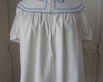 Blouse with scalloped embroidery